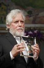 Endre Szemerédi holding his Abel Prize